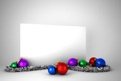 Cartel con las decoraciones coloridas de la Navidad Fotos de archivo libres de regalías