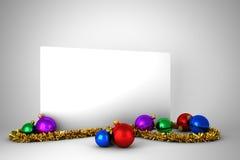 Cartel con las decoraciones coloridas de la Navidad Foto de archivo libre de regalías