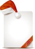 Cartel de la Navidad con el sombrero de Papá Noel Foto de archivo libre de regalías