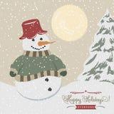 Cartel de la Navidad del vintage con el muñeco de nieve Foto de archivo libre de regalías