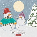 Cartel de la Navidad del vintage con los muñecos de nieve Fotos de archivo libres de regalías