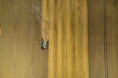 Cartel travaillant au champ de blé Images libres de droits
