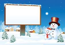 Cartelera de la Navidad con el muñeco de nieve Imagen de archivo