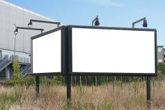 Cartelera del espacio en blanco doble para hacer publicidad Foto de archivo libre de regalías
