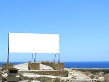 Cartelera en paisaje árido Imagen de archivo libre de regalías