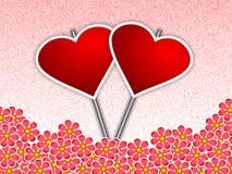 Carteles del corazón en medio de las flores Fotografía de archivo