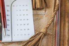 Cartella di Pen And Calendar On Leather Immagini Stock Libere da Diritti