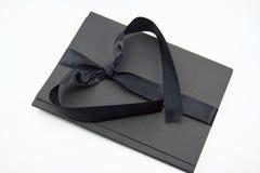 Cartella nera con nastro adesivo fotografia stock libera da diritti