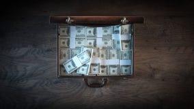 Cartella riempita di pacchetti del dollaro Fotografia Stock