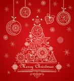 Cartellino rosso d'annata di natale di saluto con l'albero di pizzo decorativo e le bagattelle d'attaccatura Fotografia Stock