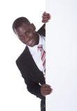 Cartello africano della tenuta dell'uomo d'affari immagine stock