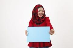 Cartello della tenuta di Musliman Fotografia Stock