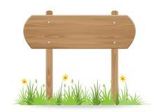 Cartello di legno su erba isolata su fondo bianco Fotografia Stock