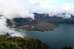 Carter lake of mt Rinjani in the clouds Stock Photos