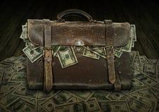 Cartera cargada con el dinero Foto de archivo libre de regalías