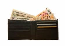 Cartera de cuero negra con las notas del euro y del dólar Imagen de archivo libre de regalías