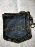 Cartera hecha de un bolsillo viejo de la mezclilla Imagen de archivo libre de regalías