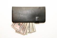 Cartera negra con los billetes de banco de dólares de EE. UU. dentro Foto de archivo libre de regalías