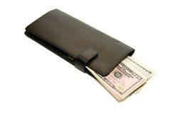 Cartera negra con los billetes de banco de dólares de EE. UU. dentro Fotos de archivo libres de regalías