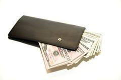 Cartera negra con los billetes de banco de dólares de EE. UU. dentro Fotografía de archivo libre de regalías