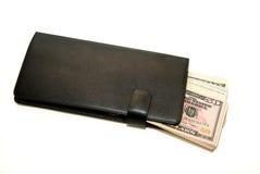 Cartera negra con los billetes de banco de dólares de EE. UU. dentro Imagen de archivo