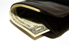 Cartera vieja con los billetes de banco de dólares de EE. UU. dentro Imágenes de archivo libres de regalías