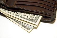 Cartera vieja con los billetes de banco de dólares de EE. UU. dentro Imagenes de archivo