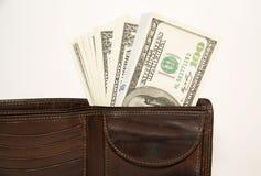 Cartera vieja con los billetes de banco de dólares de EE. UU. dentro Imagen de archivo