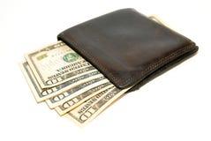 Cartera vieja con los billetes de banco de dólares de EE. UU. dentro Foto de archivo libre de regalías