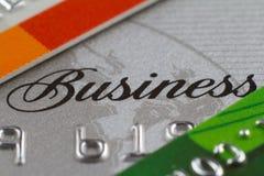Cartes de crédit avec des affaires et des numéros de mot Images stock