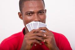 Cartes de jeu d'homme photo stock