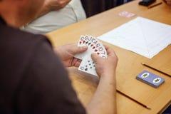 Cartes de jeu de personnes Photographie stock libre de droits