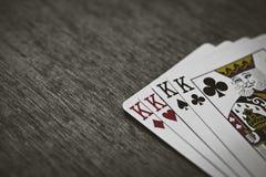 Cartes de jeu quatre rois Fond en bois Image stock
