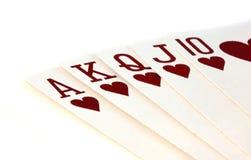 Cartes de jeu texturisées sur le blanc Images stock