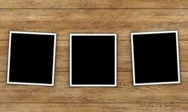 Cartes de photo sur le fond en bois Photos stock