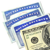 Cartes de sécurité sociale et argent d'argent liquide Photo libre de droits