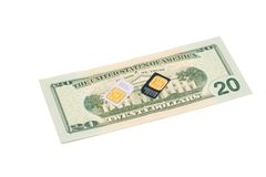Cartes de SIM pour des téléphones mobiles sur le billet d'un dollar Photographie stock libre de droits
