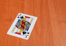 Cartes en plastique de tisonnier sur le fond en bois Image stock