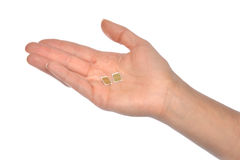 Cartes nanoes de la prise 2 SIM de main d'isolement Photographie stock libre de droits