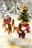 Cartes postales de Joyeux Noël et bonnes fêtes d'origami photographie stock libre de droits