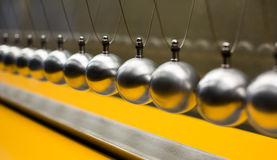 Cartesian impulse conservation law experiment with globes Royalty Free Stock Images