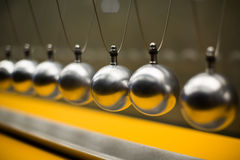 Cartesian impulse conservation law experiment with globes. Line of metallic globes for Cartesian impulse conservation law experiment Royalty Free Stock Photo
