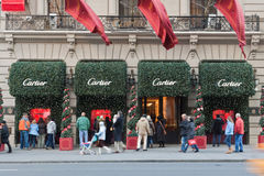 Cartier Store at Fifth Avenue New York City. Tourists walking and looking at the Cartier shop in Fifth Avenue, New York City Royalty Free Stock Photography