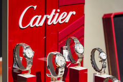 Cartier Watches In Shop Window Display. BUCHAREST, ROMANIA - JULY 10, 2014: Cartier Watches In Shop Window Display. Founded in Paris in 1847 it designs Royalty Free Stock Photo
