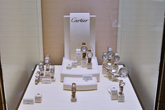 Cartier watches in showcase store Stock Photography