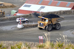 Carting the coal. WESTPORT, NEW ZEALAND, AUGUST 31, 2013: 70 ton truck passes a 4WD at Stockton open cast coal mine on August 31, 2013 near Westport, New Zealand Stock Photo
