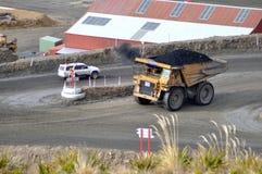 Carting de steenkool stock foto