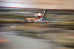 Carting man. Artistically motion blurred image of a cart race Stock Photography