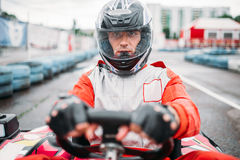 Carting race, go kart driver in helmet, front view. Carting race, go kart driver in helmet on karting speed track, front view Royalty Free Stock Images