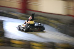 Carting woman. Artistically motion blurred image of a cart race Stock Photo